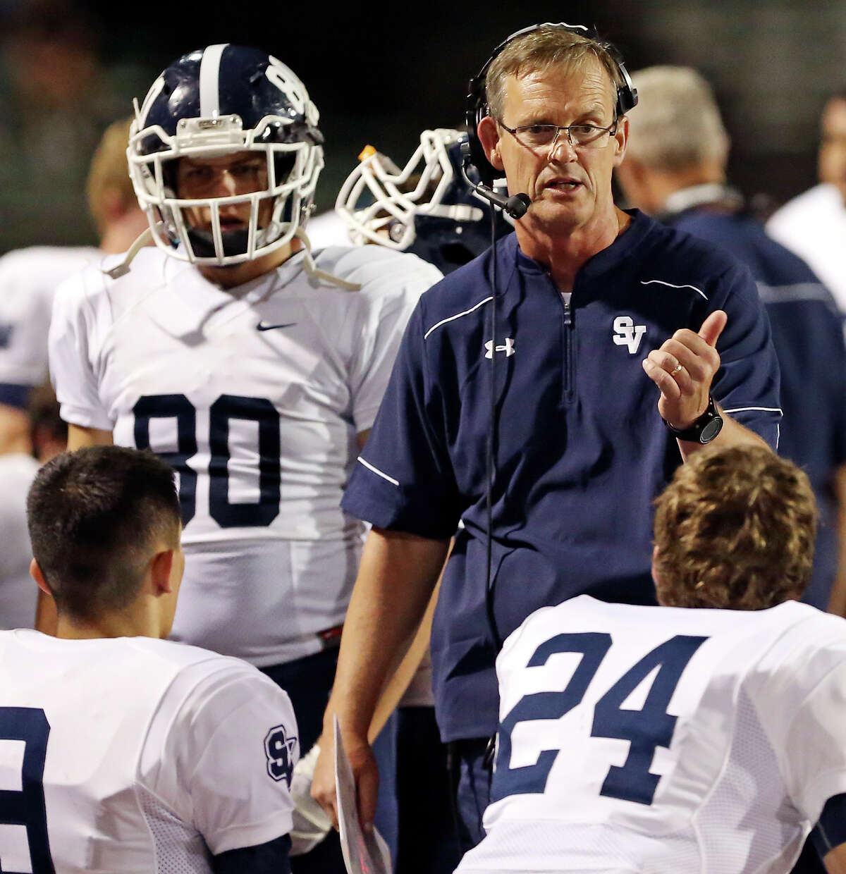 Smithson Valley head coach Larry Hill talks with players during first half action against Clemens on Oct. 16, 2015 at Lehnhoff Stadium.