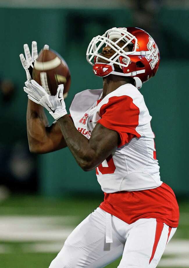 Houston wide receiver Demarcus Ayers (10) makes a catch during practice before an NCAA college football game between Tulane and Houston in New Orleans, Friday, Oct. 16, 2015. (AP Photo/Max Becherer) Photo: Max Becherer, Associated Press / FR 171354AP