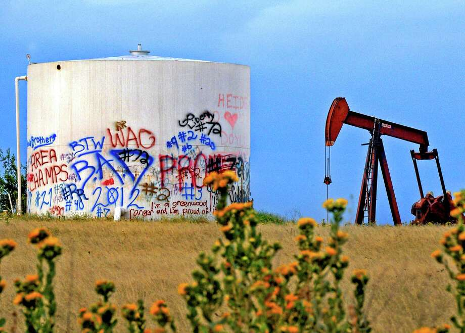 Graffiti covers oil field equipment in Greenwood, Texas. The oil industry says that if crude exports are allowed, domestic production would increase sharply. Photo: James Durbin, MBR / Reporter-Telegram