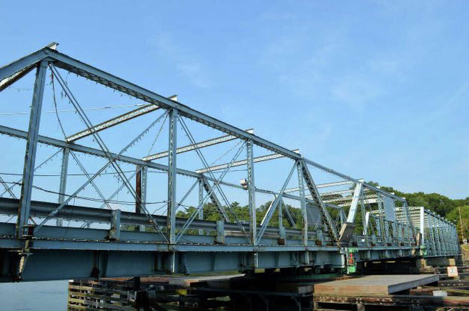 "The Bridge Street bridge -- formally, the William F. Cribari Memorial Bridge -- is ""severely deficient,"" according to the state Department of Transportation, which is studying whether to repair or replace the span over the Saugatuck River. Photo: File Photo / File Photo / Westport News"