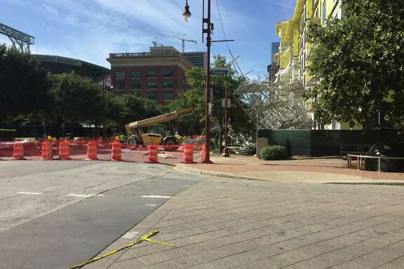 Cleanup crews began clearing the scaffolding that collapsed Friday just opposite Minute Maid Park, wounding 6 construction workers.