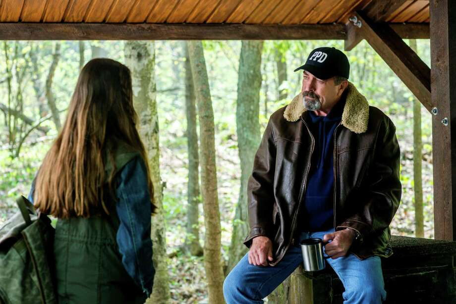 Jesse Stone (Tom Selleck) takes an interest in the welfare of a teenage girl who has major problems at home in the latest installment of the murder mystery movie series, 'Lost in Paradise' on Hallmark Channel. October, 2015  Once a Los Angeles homicide detective, Police Chief Jesse Stone now presides over the quiet, seaside village of Paradise, Massachusetts. When the facts don't add up in a brutal Boston-area murder case, Jesse opens an investigation filled with surprises, unlikely suspects and grave danger. Though it's widely believed the murder was committed by an incarcerated serial killer, Jesse suspects another killer is at large and is hell-bent on bringing him to justice.   Photo:  Mackenzie Foy, Tom Selleck  Credit:  Copyright 2015 Crown Media United States, LLC/Photographer:  Chris Reardon Photo: Chris Reardon / Crown Media / © Crown Media United States, LLC