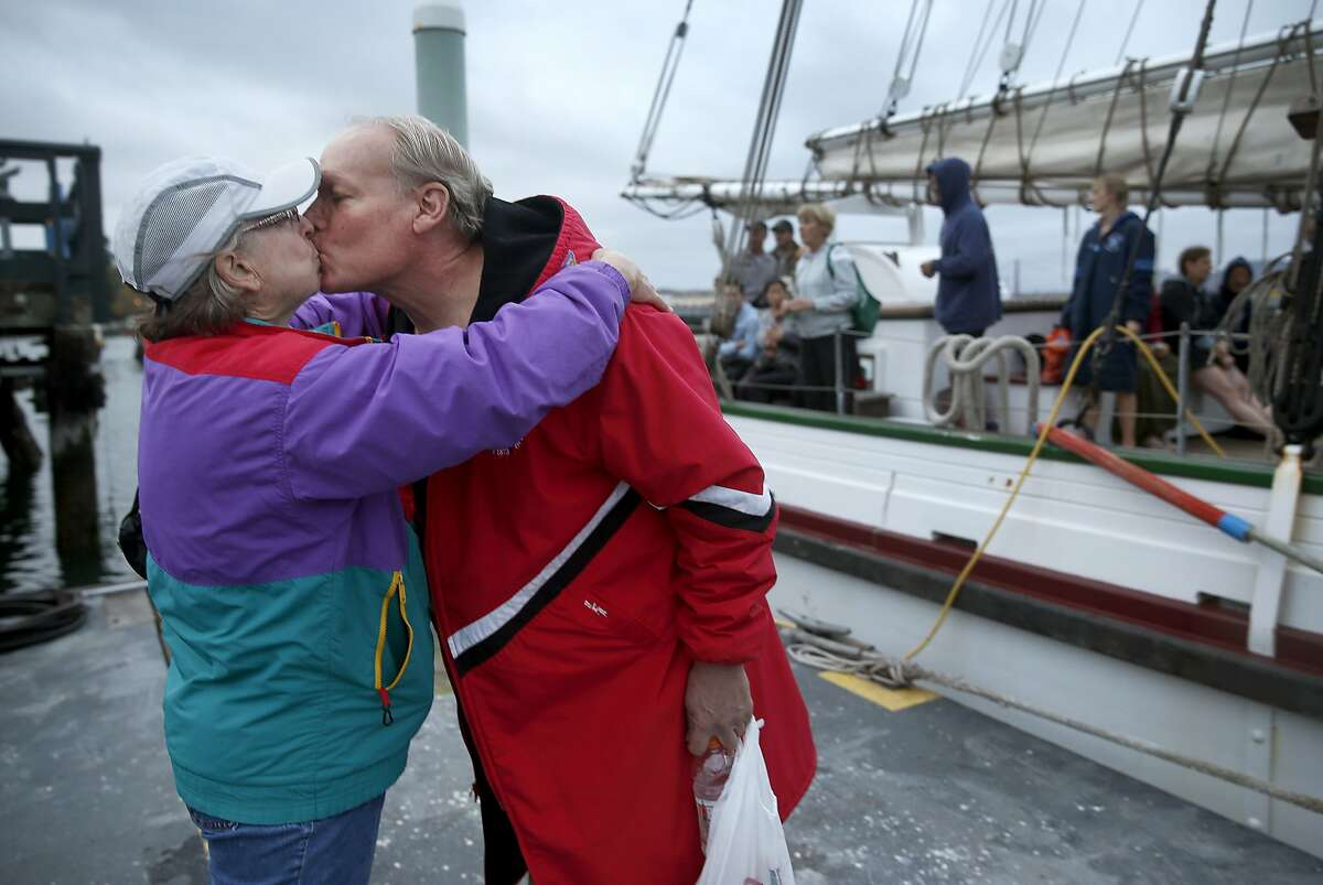 Linda Nowell gives her husband Keith Nowell a good luck kiss before he competes in his 25th Escape From Alcatraz triathlon at Aquatic Park in San Francisco, Calif. on Saturday, Oct. 17, 2015. Race organizers from the Dolphin Club took extra precautions for this year's event, including additional pilot boats, after great white shark sightings in the bay in recent weeks.
