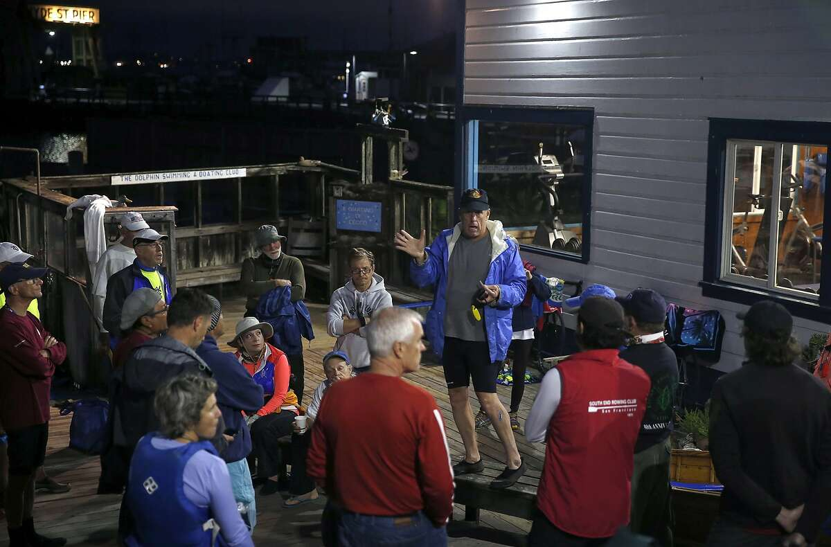 John Nogue (center) advises pilots to keep swimmers from straying off course and to keep an eye out for sharks at a pre-race briefing for the Dolphin Club's Escape From Alcatraz triathlon at Aquatic Park in San Francisco, Calif. on Saturday, Oct. 17, 2015. Organizers took extra precautions for this year's event, including additional pilot boats, after great white shark sightings in the bay in recent weeks.