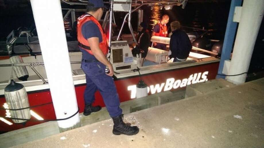 A photo of the towboat  Coast Guard authorities hauled to the Galveston Yacht Club after it became disabled for trying to help two people who had themselves gotten stuck near the Texas City Dyke.