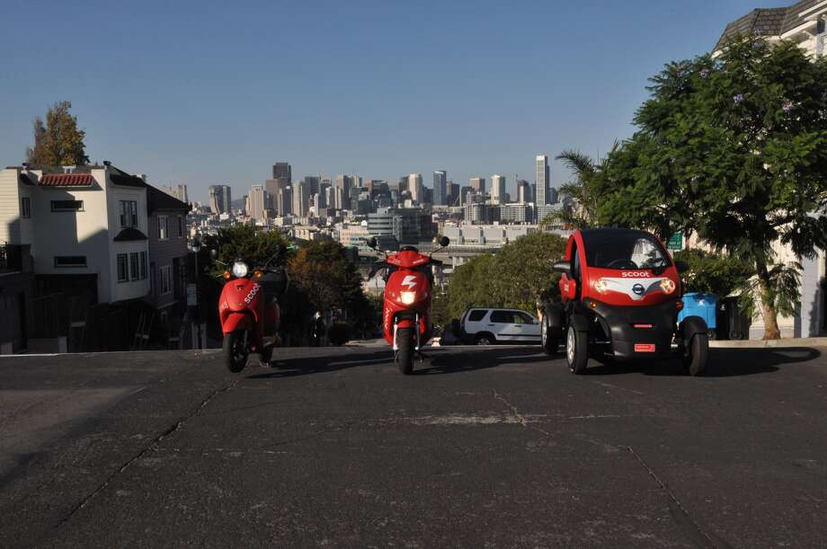 The electric Scoot Quad car is joining the company's fleet of electric mopeds, which come in two sizes. Photo: Scoot Networks