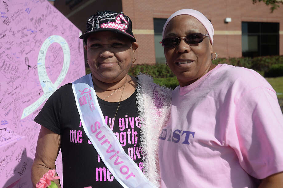 Nine-year survivor Marva Gibson and Sandra Reed took part in the American Cancer Society's annual Making Strides Against Breast Cancer 5K walk Saturday at Lamar University. A variety of entertainers were stationed throughout the route to cheer on walkers as they helped raise funds and awareness for the cause. Photo taken Saturday, October 17, 2015 Kim Brent/The Enterprise Photo: Kim Brent / Beaumont Enterprise