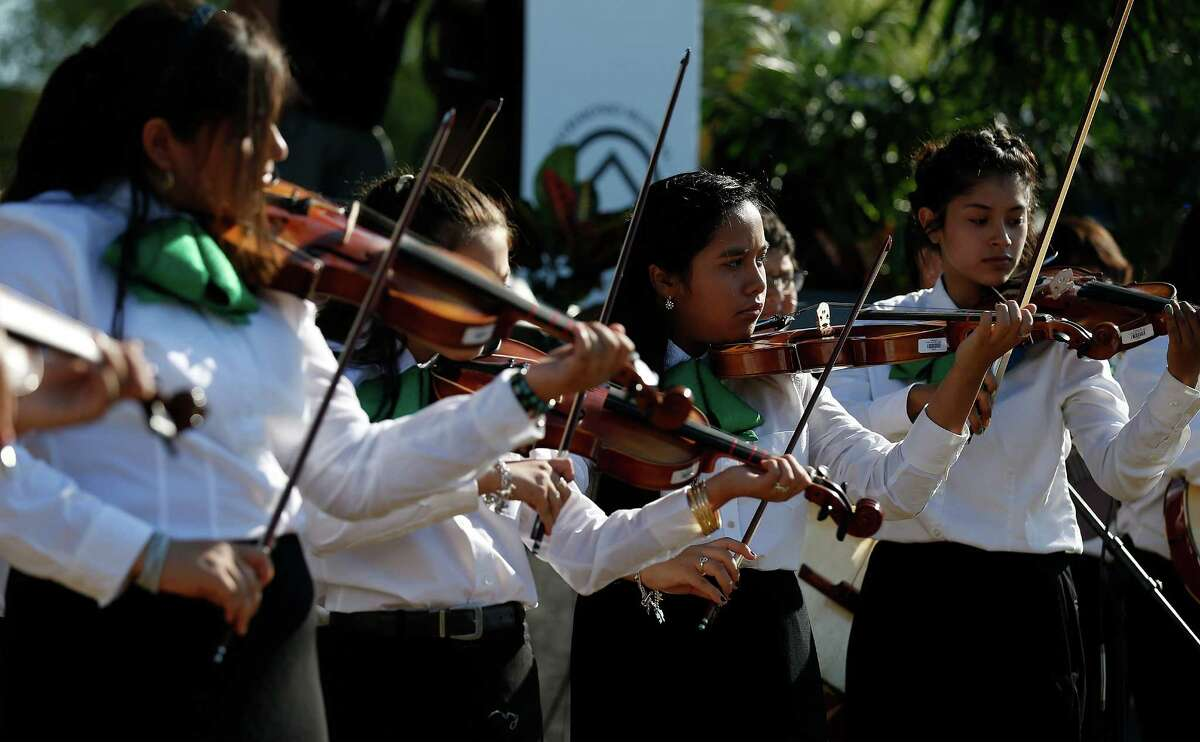 Leal Middle School students Nalleli Ramos (right) and Xena Arredondo play the violin with other members of the Harlandle School District mariachi group during the World Heritage Inscription Ceremony at Mission San Jose on Saturday, Oct. 17, 2015. Hundreds of guests and the public watched as young mariachis from Harlandale Independent School District performed as well as watched ceremonies conducted by two Indigenous groups. The whole affair was highlighted by the unveiling of a plaque that will be displayed at San Jose to mark the new World Heritage designation for all five of the missions around the city.
