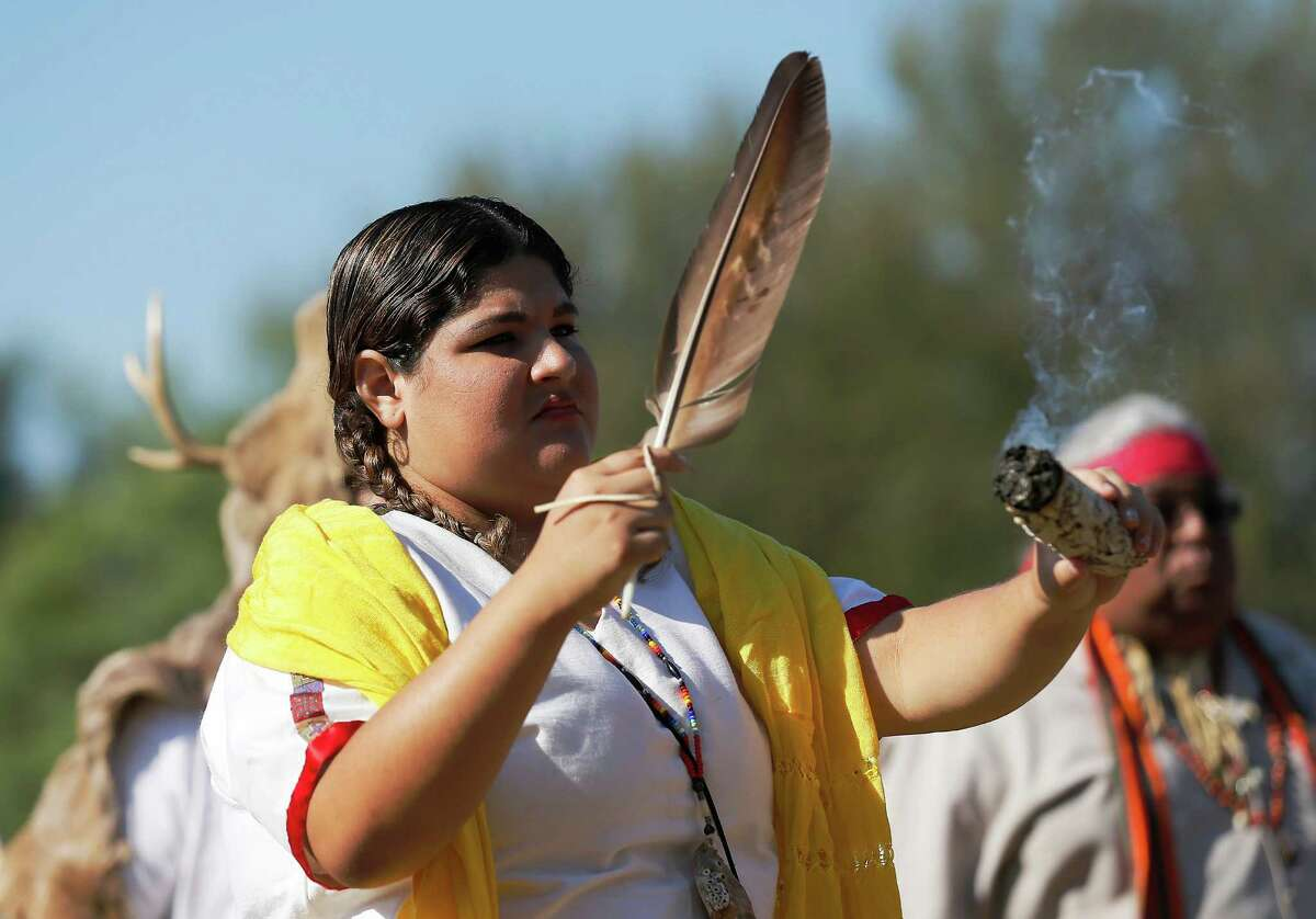 Alexis Reyes joins in performing ceremony with the indigenous group, Tap Pilam Coahuiltecan Nation, during the World Heritage Inscription Ceremony at Mission San Jose on Saturday, Oct. 17, 2015. Hundreds of guests and the public watched as young mariachis from Harlandale Independent School District performed as well as watched ceremonies conducted by two Indigenous groups. The whole affair was highlighted by the unveiling of a plaque that will be displayed at San Jose to mark the new World Heritage designation for all five of the missions around the city.