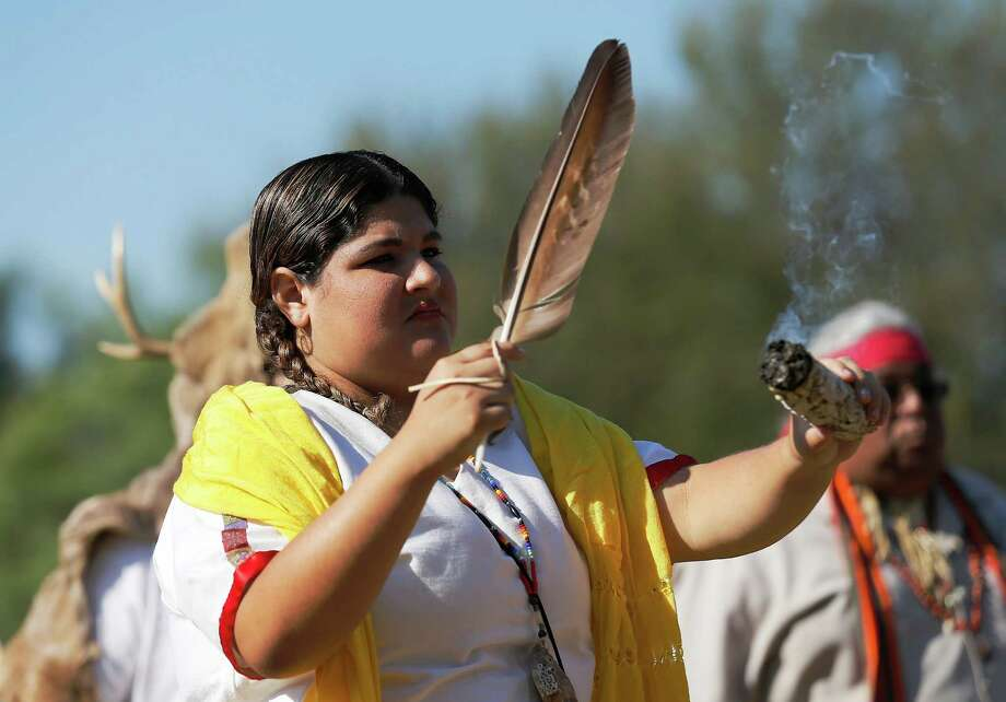 Alexis Reyes joins in performing ceremony with the indigenous group, Tap Pilam Coahuiltecan Nation, during the World Heritage Inscription Ceremony at Mission San Jose on Saturday, Oct. 17, 2015. Hundreds of guests and the public watched as young mariachis from Harlandale Independent School District performed as well as watched ceremonies conducted by two Indigenous groups. The whole affair was highlighted by the unveiling of a plaque that will be displayed at San Jose to mark the new World Heritage designation for all five of the missions around the city. Photo: Kin Man Hui, San Antonio Express-News / ©2015 San Antonio Express-News