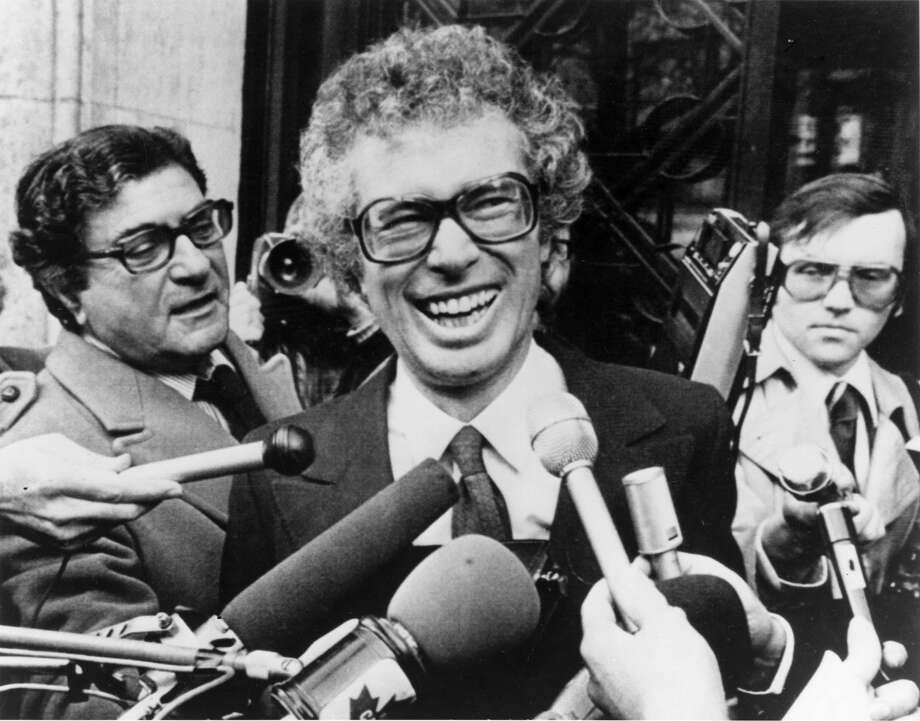 FILE - In this Jan. 31, 1980, file photo, Ken Taylor, Canadian Ambassador to Iran, laughs as he answers questions during a meeting with journalists outside the Canadian Embassy in Paris. Taylor, who kept Americans hidden at his residence during the 1979 Iran hostage crisis, died Thursday, Oct. 15, 2015, after a two month battle with colon cancer, his wife Pat said. He was 81. (AP Photo/File) Photo: STF / AP