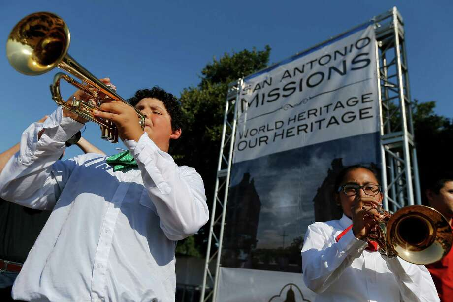 Leal Middle School's Ramon Pena (left) and Delilah Sandoval from Harlandale Middle School perform with district's marariachi group at the World Heritage Inscription Ceremony at Mission San Jose on Saturday, Oct. 17, 2015. Hundreds of guests and the public watched as the young mariachis played. Ceremonies conducted by two Indigenous groups also marked the occasion. The whole affair was highlighted by the unveiling of a plaque that will be displayed at San Jose to signify the new World Heritage designation for all five of the missions around the city.  (Kin Man Hui/San Antonio Express-News) Photo: Kin Man Hui, Staff / San Antonio Express-News / ©2015 San Antonio Express-News