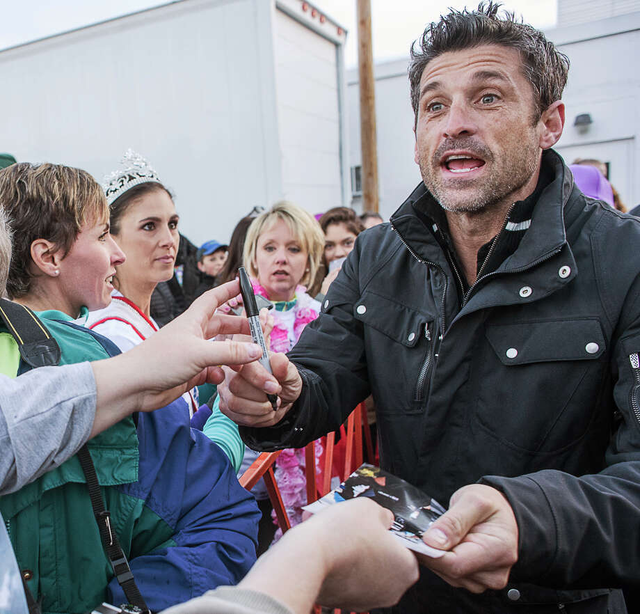 Patrick Dempsey signs autographs before the start of the cancer fundraiser in Lewiston, Maine. Photo: Andree Kehn /Lewiston Sun Journal / The Lewiston Sun-Journal