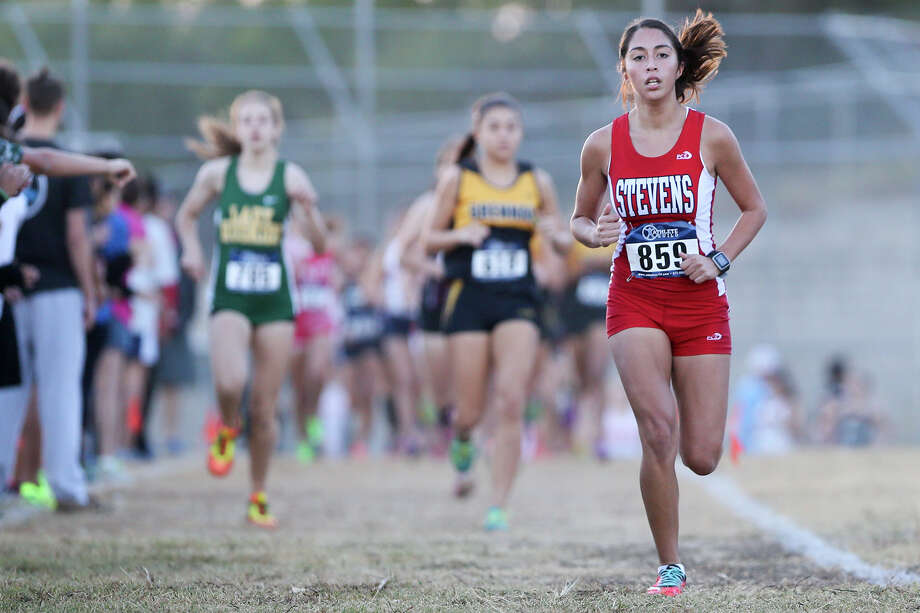 Stevens' Elizabeth Alvarado, who led from the start, runs ahead of the pack en route to winning the girls District 27-6A title  in 19 minutes, 1.34 seconds Saturday at Brandeis High School. It was her first district title after finishing third last year. Photo: Photos By Marvin Pfeiffer / San Antonio Express-News / Express-News 2015