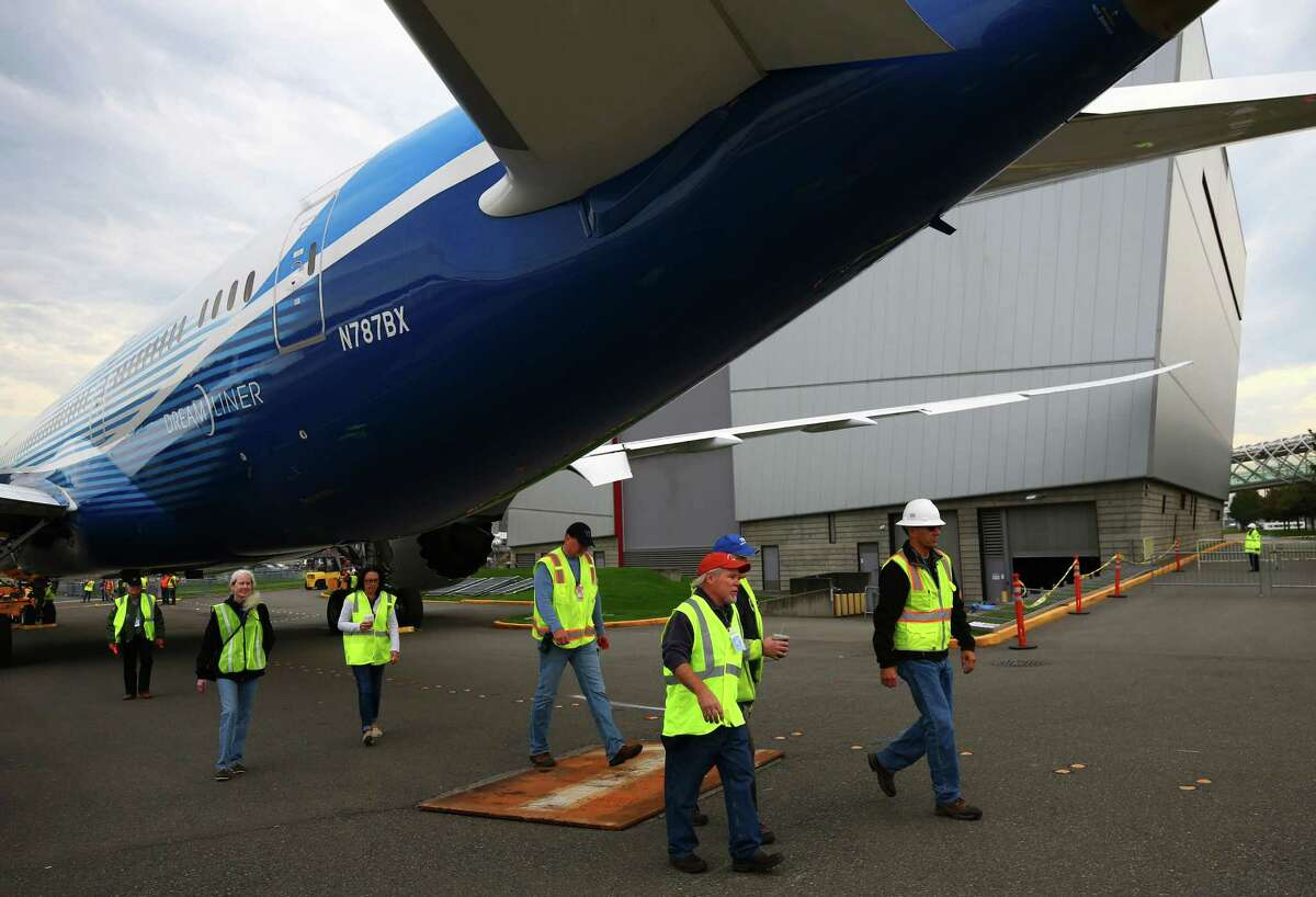 Boeing staff prepares to move a 787 Dreamliner and a B-17 across E Marginal Way to their new home in the half-finished Museum of Flight Aviation Pavilion in Seattle, Saturday, October 17, 2015. The Pavilion will eventually hold 21 planes and open to the public next summer.