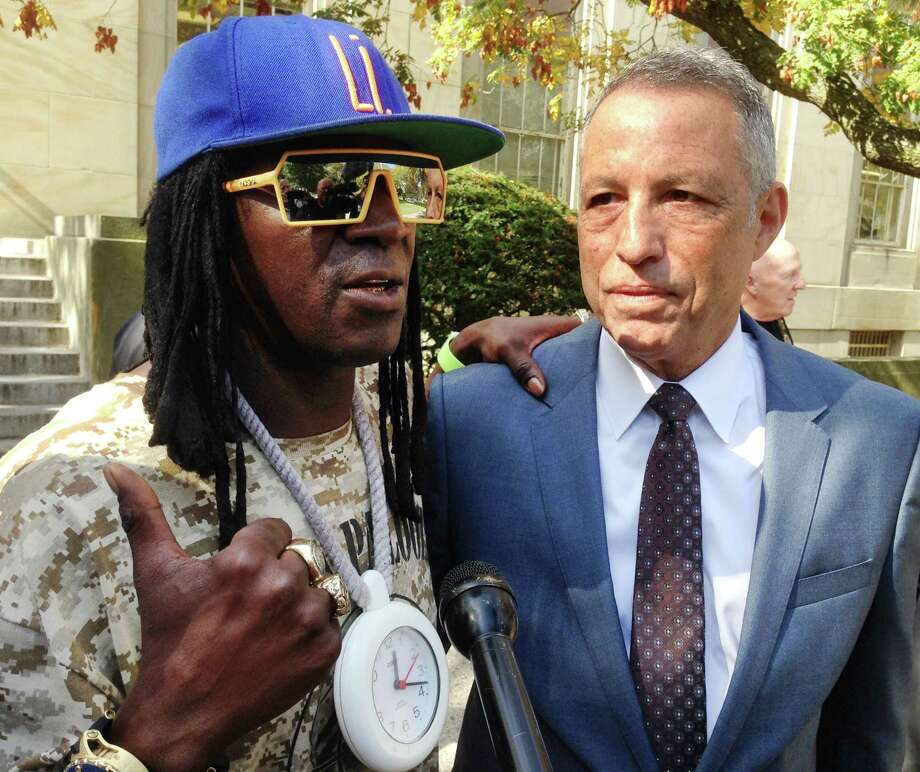 Flavor Flav talks to reporters after plead- ing guilty to one count of aggravated unlicensed operation of a motor vehicle in Mineola, N.Y. Photo: Frank Eltman /Associated Press / AP