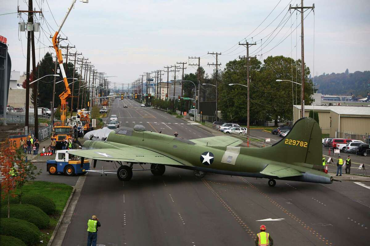Boeing staff moves a B-17 bomber across E Marginal Way to its new home in the half-finished Museum of Flight Aviation Pavilion in Seattle, Saturday, October 17, 2015. The Pavilion will eventually hold 21 planes and open to the public next summer.