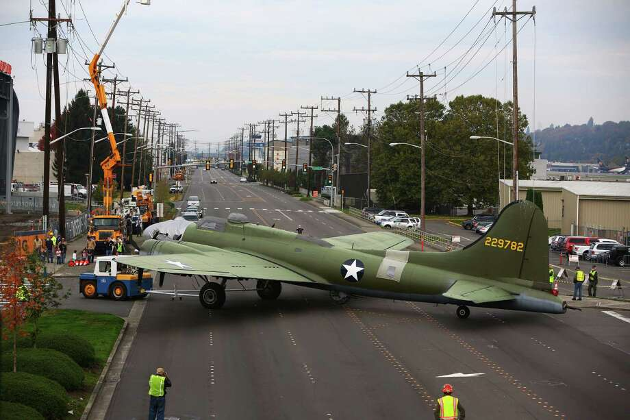 Boeing staff moves a B-17 bomber across E Marginal Way to its new home in the half-finished Museum of Flight Aviation Pavilion in Seattle, Saturday, October 17, 2015.  The Pavilion will eventually hold 21 planes and open to the public next summer. Photo: GENNA MARTIN, SEATTLEPI.COM / SEATTLEPI.COM