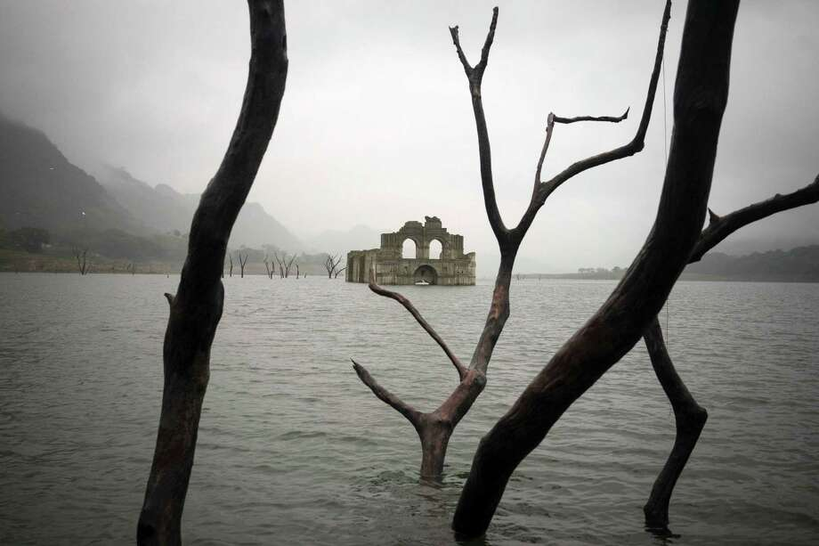 A drought has caused the Nezahualcoyotl reservoir near the town of Nueva Quechula in Chiapas state, Mexico, to fall, revealing the remains of a mid-16th-century church known as the Temple of Santiago or the Temple of Quechula. Photo: David Von Blohn /Associated Press / AP