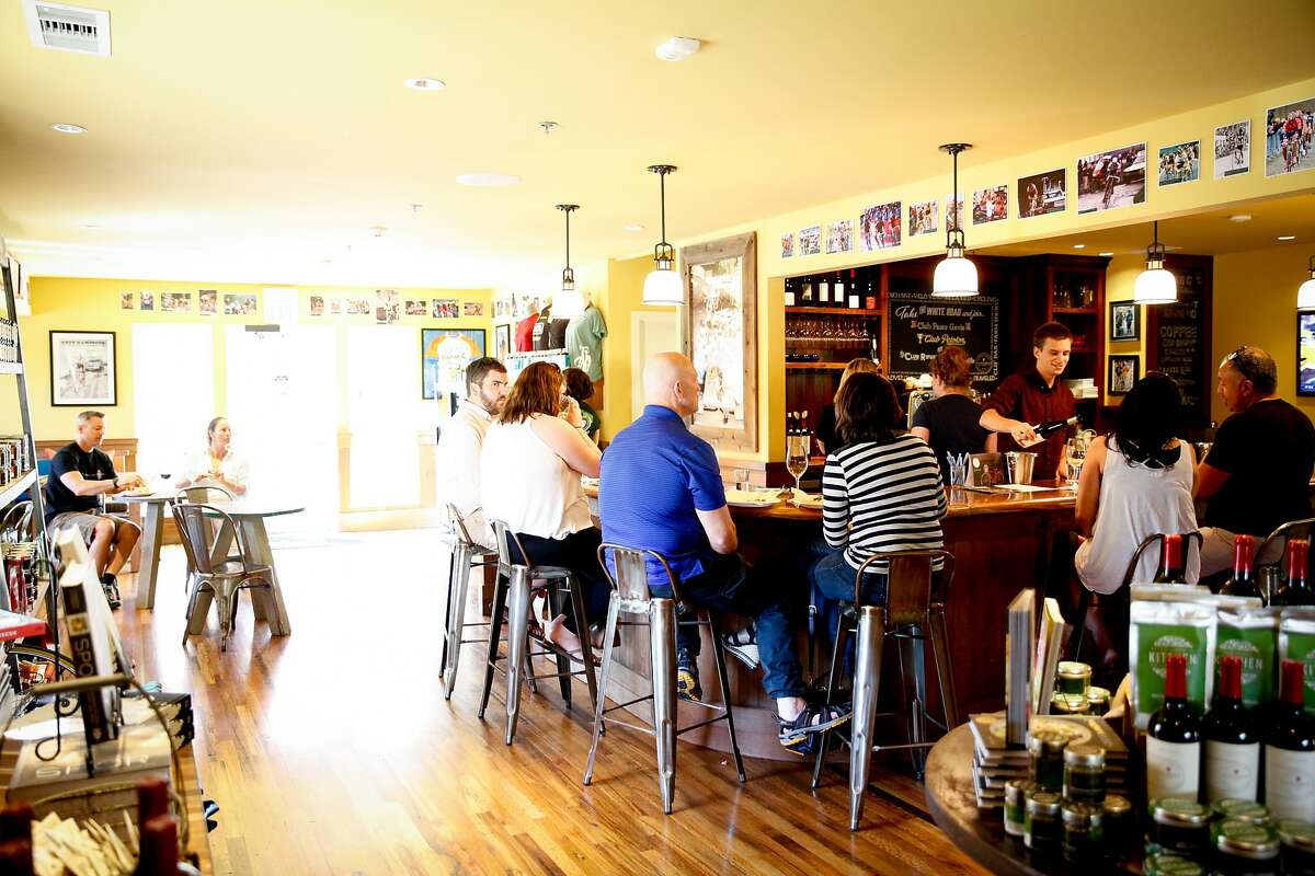Guests at the bar in the Velo Vino tasting room in St. Helena, Calif., on Sunday, October 11, 2015.