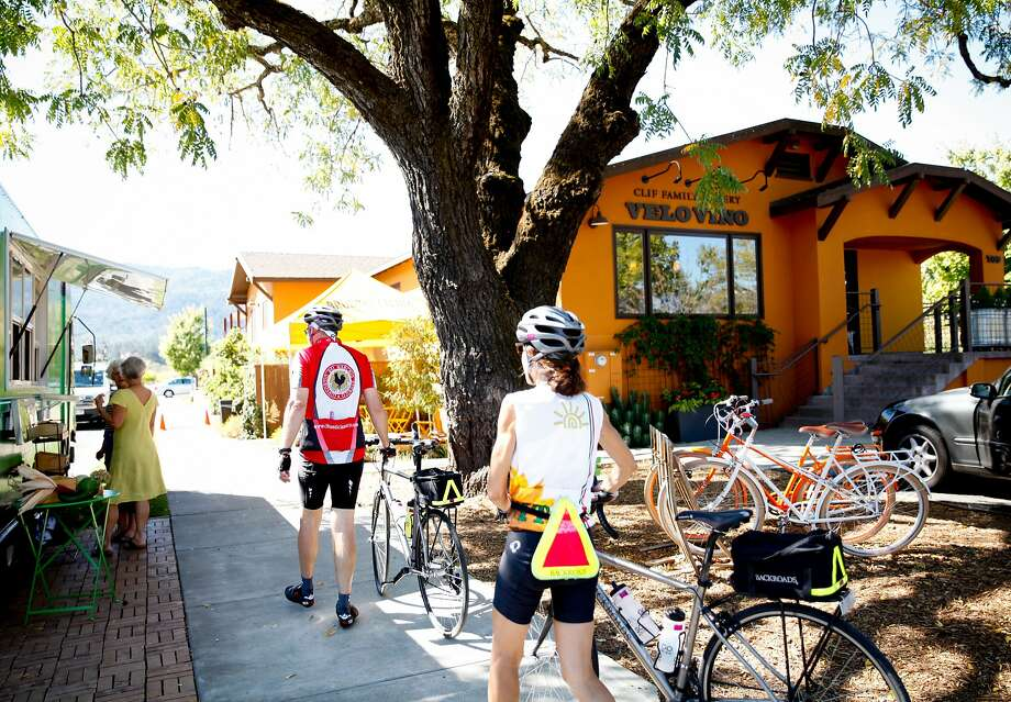 Bicyclists walk up to the Velo Vino tasting room in St. Helena, Calif., on Sunday, October 11, 2015. Photo: Sarah Rice, Special To The Chronicle