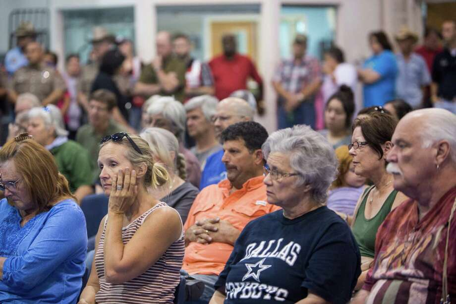 Evacuees, volunteers and community members gather for a meeting about the Hidden Pines Fire in a Red Cross shelter set up in Smithville on Friday. Photo: Carolyn Van Houten /San Antono Express-News / 2015 San Antonio Express-News