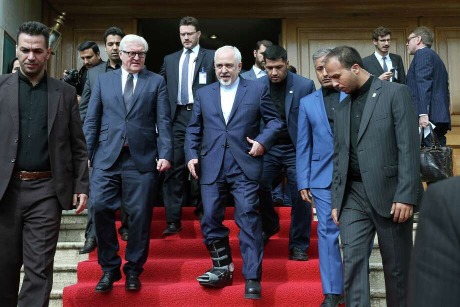 Iranian Foreign Minister Mohammad Javad Zarif, center, has expressed fear that if U.S. sanctions continue, Iran will suspend work on dismantlement of its nuclear program.  Photo: Ebrahim Noroozi, STR / AP
