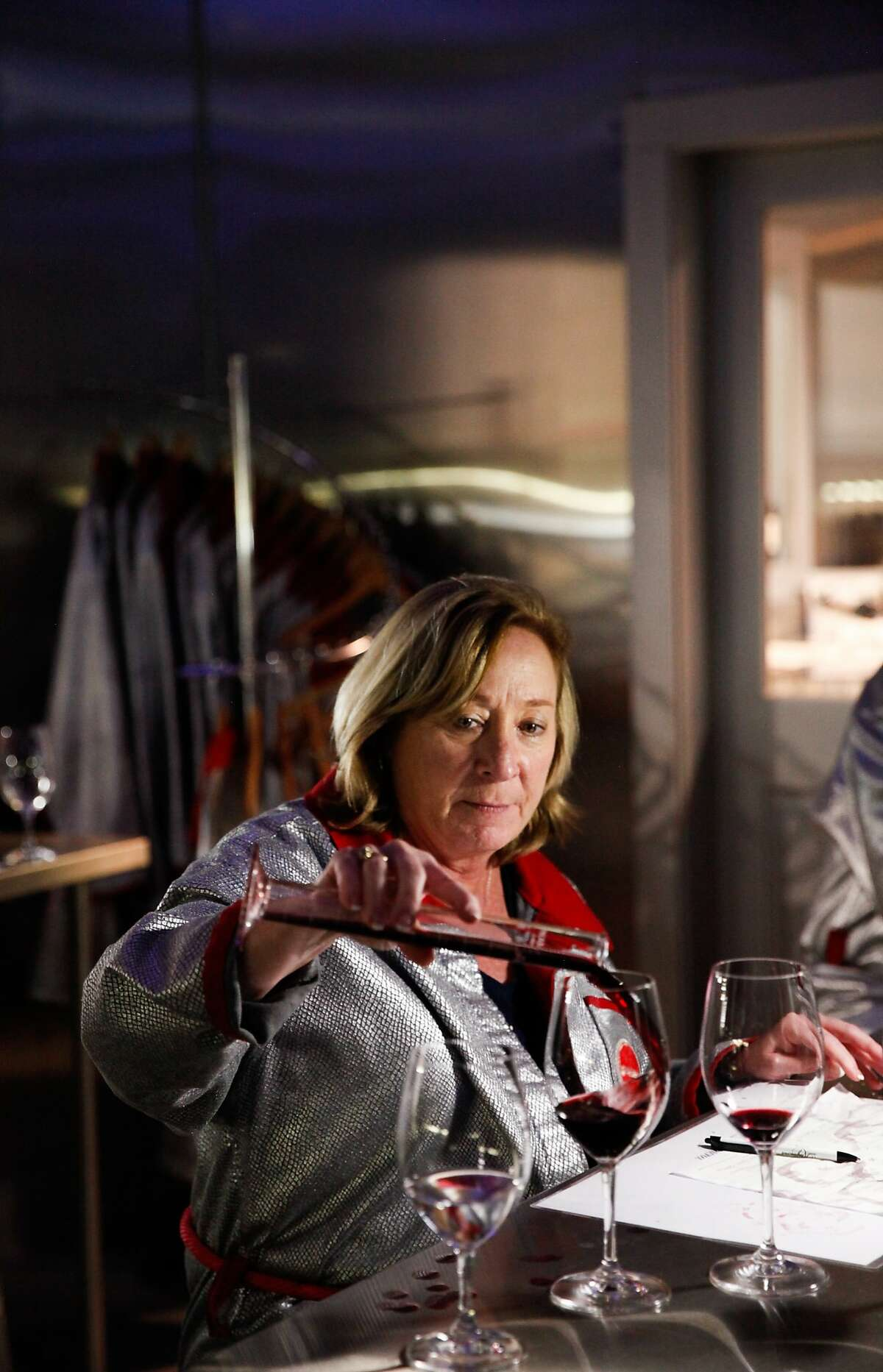 Sue Bezemes, of Dublin, Ohio, blends wines during the Winemaker for a Day class at Raymond Vineyard in St. Helena, Calif., on Monday, October 12, 2015.