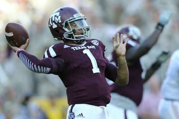 Texas A&M Aggies quarterback Kyler Murray (1) throws an interception in the fourth quarter. Photos of Texas A&M Aggies football game against Alabama Crimson Tide on  Saturday, Oct. 17, 2015, in Houston.