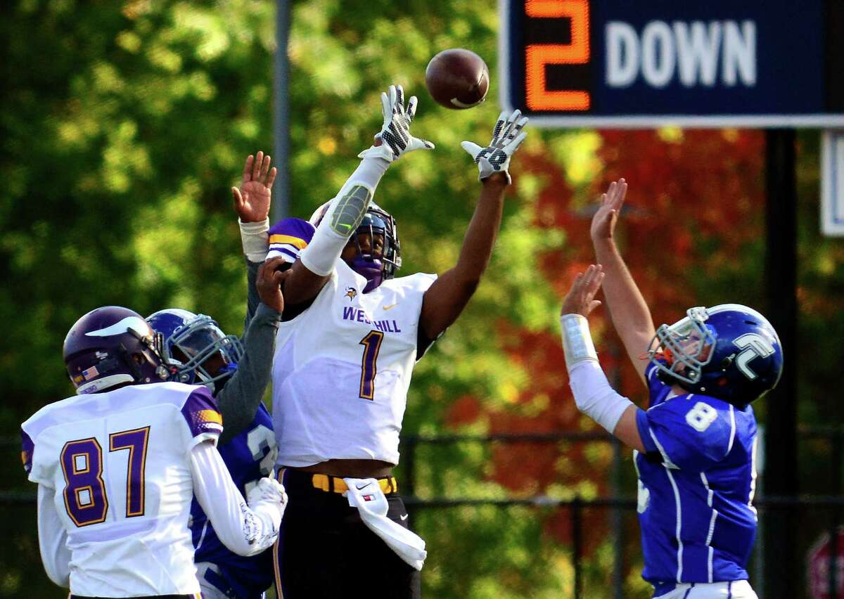 Westhill's Carl Gedeon reaches for a pass during high school football action against Fairfield Ludlowe in Fairfield, Conn. on Saturday October 17, 2015. The pass to Gedeon was incomplete.