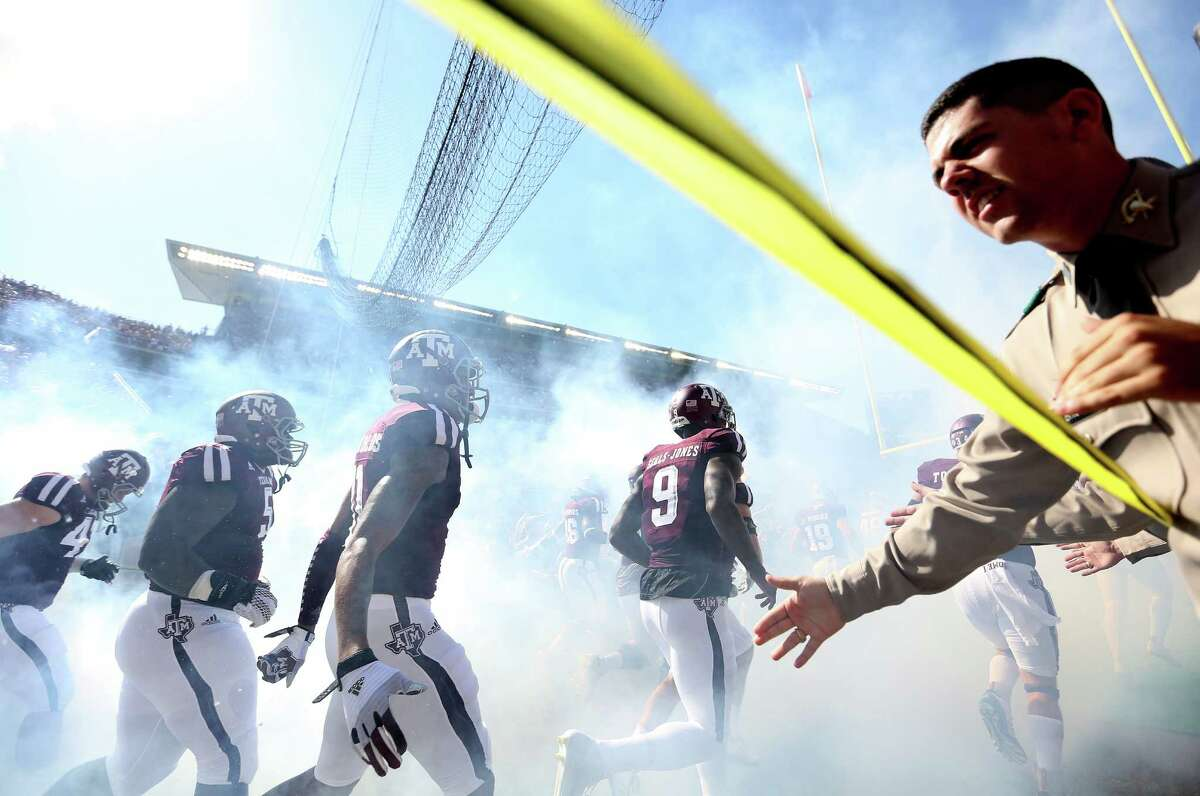Aggies make their way onto the field during pre-game ceremony. Photos of Texas A&M Aggies football game against Alabama Crimson Tide on Saturday, Oct. 17, 2015, in Houston.
