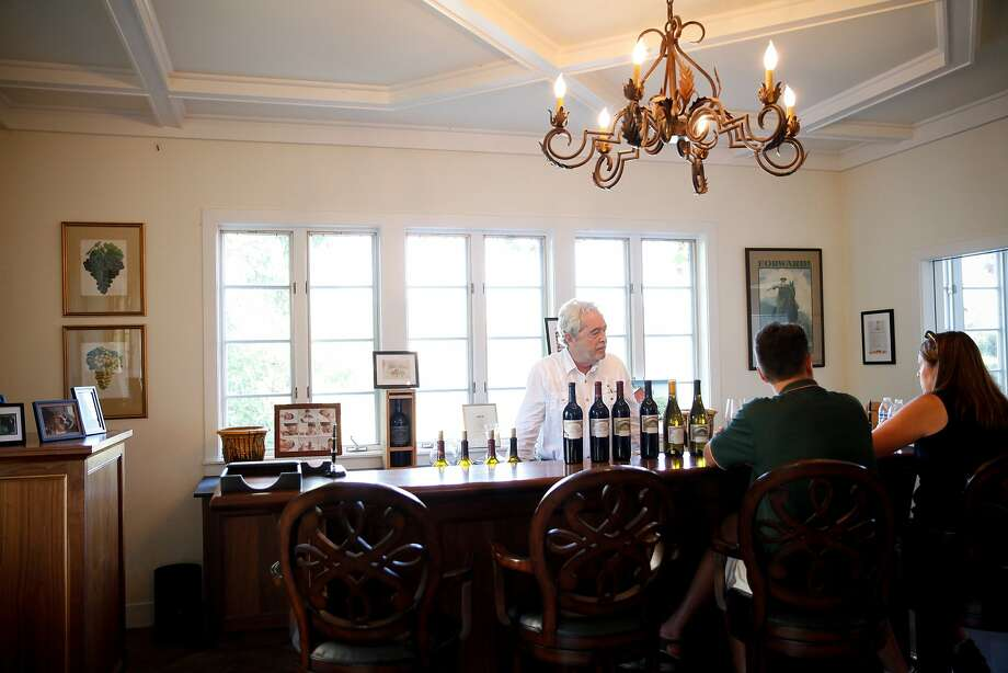 John Buehler, the owner of Buehler Vineyards, pours wine for guests in the tasting room in St. Helena, Calif., on Tuesday, October 13, 2015. Photo: Sarah Rice, Special To The Chronicle