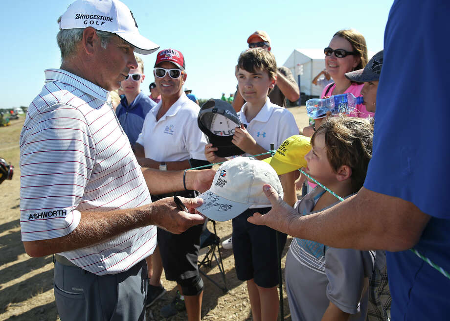 Fred Couples hangs around to sign autographs after his second round of the San Antonio Championship at the TPC San Antonio, AT&T Canyons Course on Oct.17, 2015. Photo: Tom Reel /San Antonio Express-News