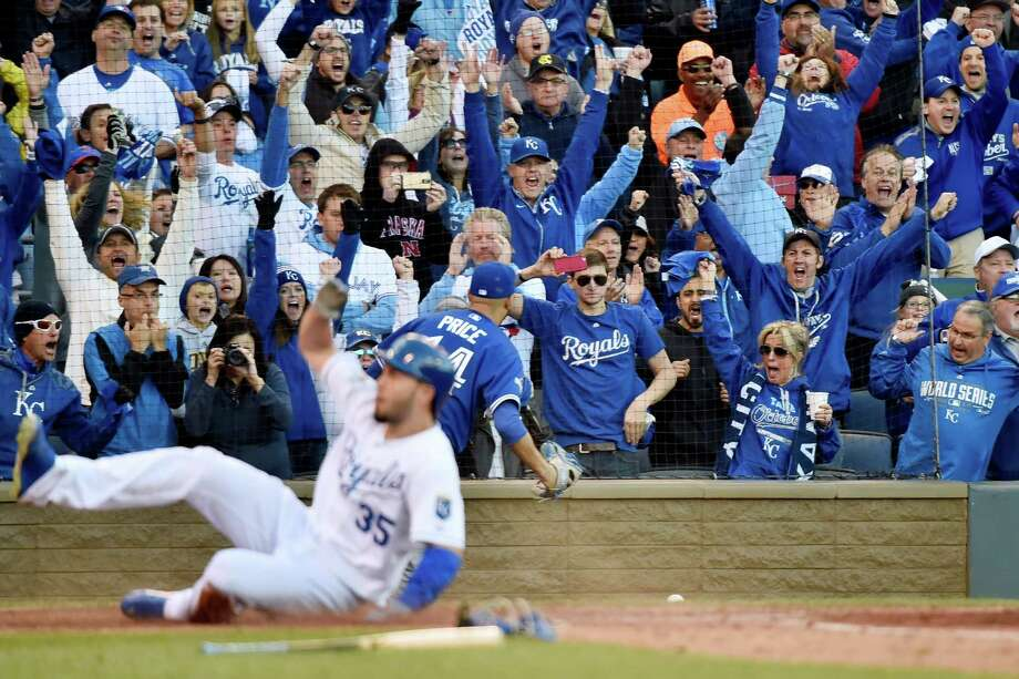 Kansas City fans cheer as Eric Hosmer becomes part of the Royals' five-run seventh against the Blue Jays. Photo: Nathan Denette, SUB / CP