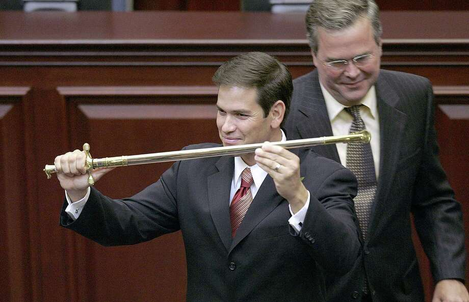 When their relationship was smoother in 2005, then-Florida Rep. Marco Rubio, left, was presented a sword by then-Gov. Jeb Bush during ceremonies honoring Rubio as the Florida House speaker. But now the GOP rivals are bickering. Photo: Phil Coale, STF / AP
