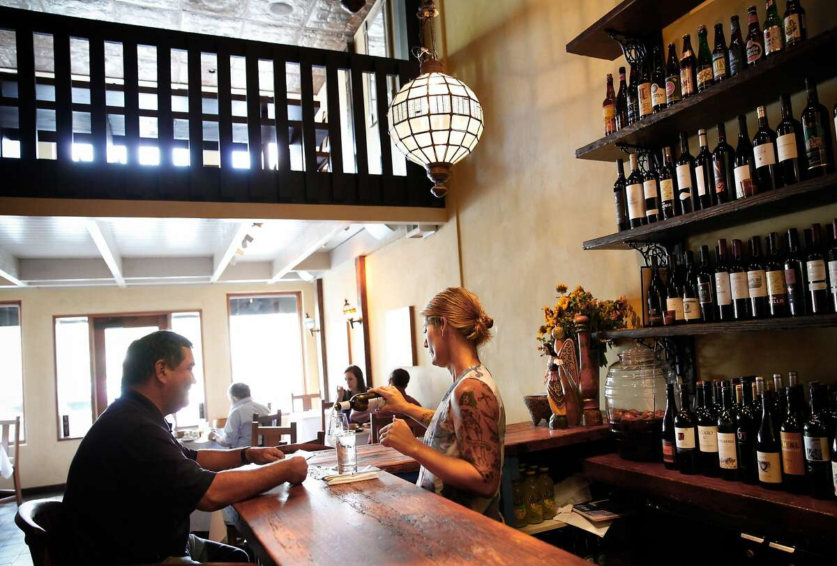 Mindi Robinson, the manager at Zuzu, serves a guests in the restaurant in Napa, Calif., on Thursday, October 15, 2015.