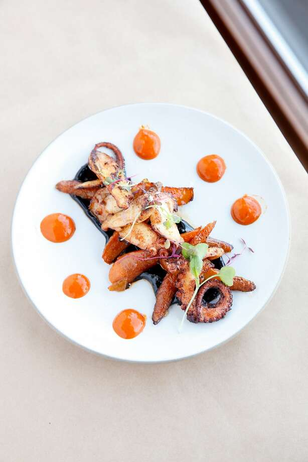 Seared octopus with roasted baby carrots, mojo picon and a black garlic aioli at ZuZu. Photo: Sarah Rice, Special To The Chronicle