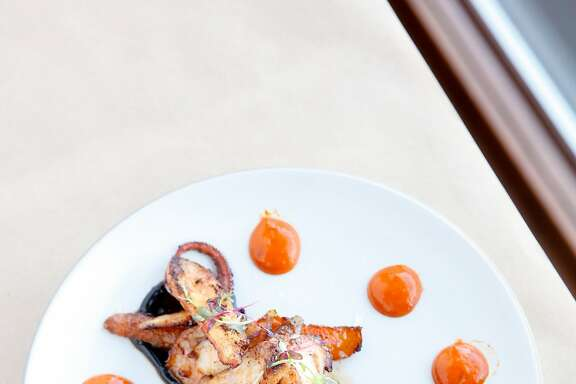 The seared octopus with roasted baby carrots, mojo picon and a black garlic aioli at Zuzu in Napa, Calif., on Thursday, October 15, 2015.