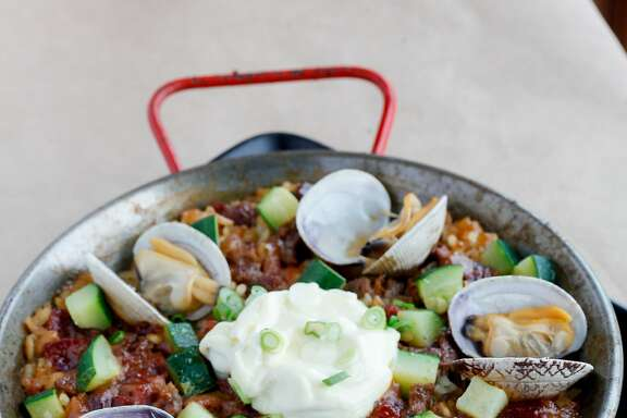 The paella del dia with Bomba rice, chorizo, clams, sofrito and lamb and beef at Zuzu in Napa, Calif., on Thursday, October 15, 2015.