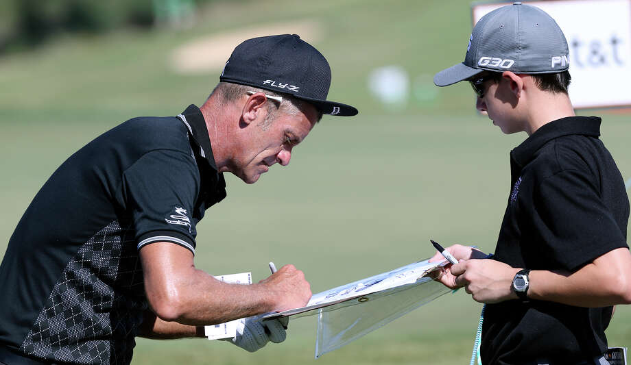Jesper Parnevik signs an autograph for Brendan Farley after the second round of the San Antonio Championship at the TPC San Antonio, AT&T Canyons Course on Oct. 17, 2015. Photo: Tom Reel /San Antonio Express-News / San Antonio Express-News