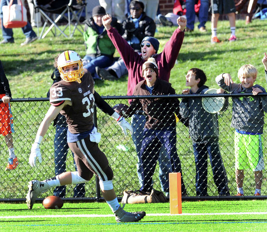 Fans reacts just after Kieran Dowley (#33) of Brunswick, center, scored a touch down on a reception from Brunswick quarterback Nicky Henkel during the second quarter of the high school football game between Brunswick School and Trinity Pawling at Brunswick in Greenwich, Conn., Saturday, Oct. 17. 2015. Brunswick defeated Trinity Pawling, 26-16. Photo: Bob Luckey Jr. / Hearst Connecticut Media / Greenwich Time