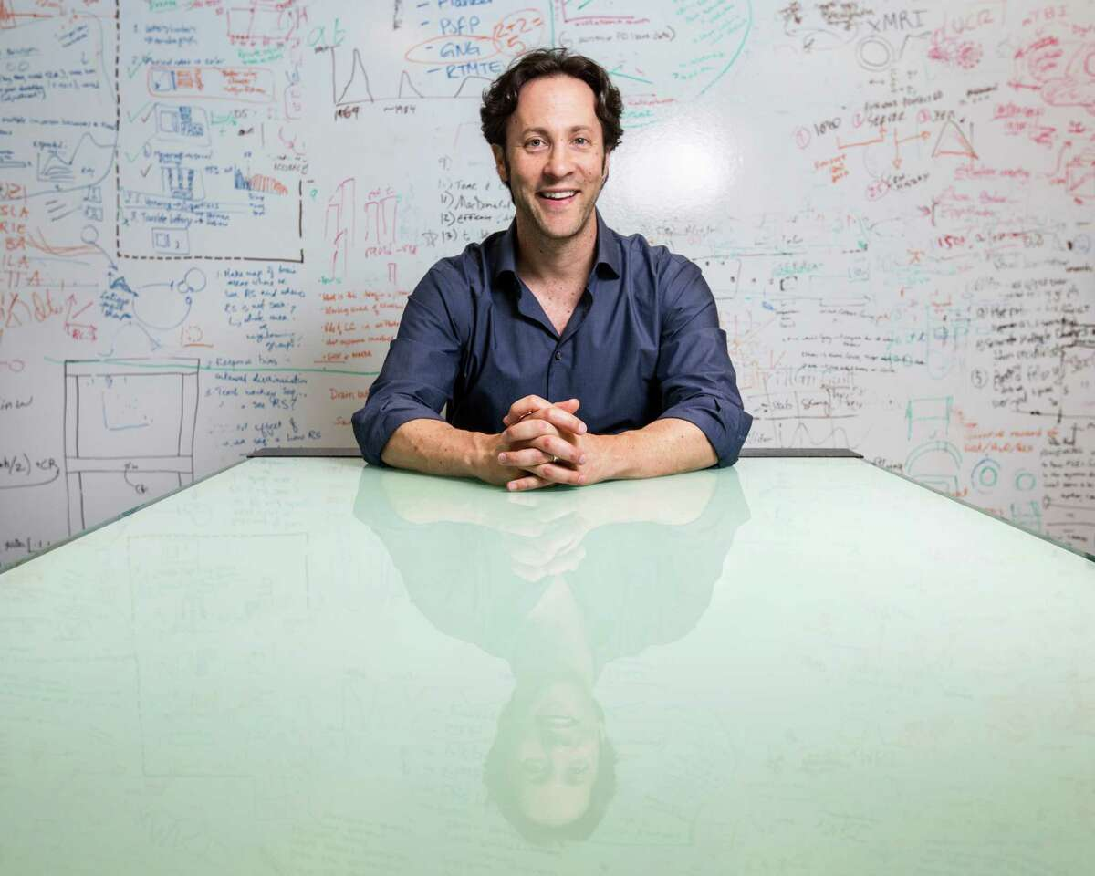 """David Eagleman, in his lab at Baylor College of Medicine. The neuroscientist has written some best-selling books, including """"Sum"""" and """"Incognito."""" ( Jon Shapley / Houston Chronicle )"""