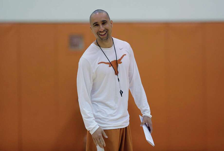 New Texas head basketball coach Shaka Smart runs drills during a practice at the team's facility, Tuesday, Oct. 13, 2015, in Austin, Texas. Smart is the first African-American men's basketball coach at Texas.(AP Photo/Eric Gay) Photo: Eric Gay, STF / Associated Press / AP