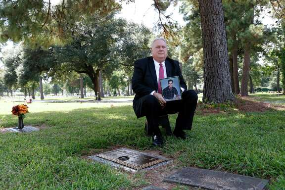 James McSwain, principal of Lamar High School, whose adult son, Phillip died in 2009 from a combination of alcohol and prescription medication, photographed at his grave on Wednesday, Sept. 30, 2015. ( Karen Warren / Houston Chronicle )