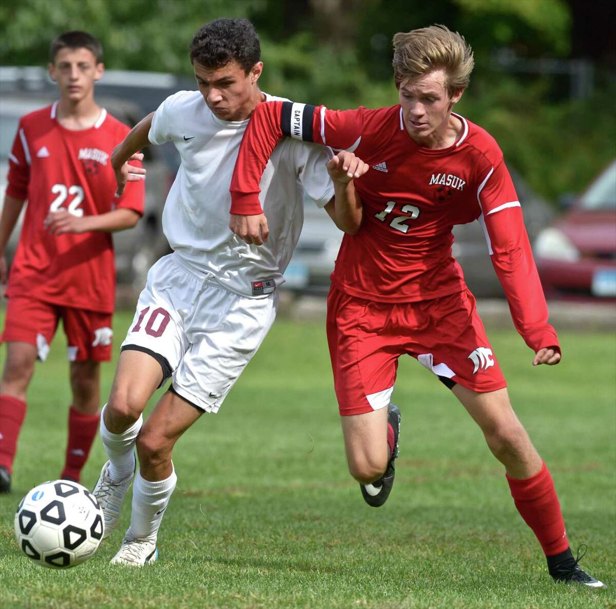 FILE PHOTO: Bethel's Frank Musser (10) and Masuk's Michael Snajder (12) battle for the ball in the boys high school soccer game between Masuk and Bethel high schools on Saturday, September 26, 2015, at Rourke Field, in Bethel, Conn.