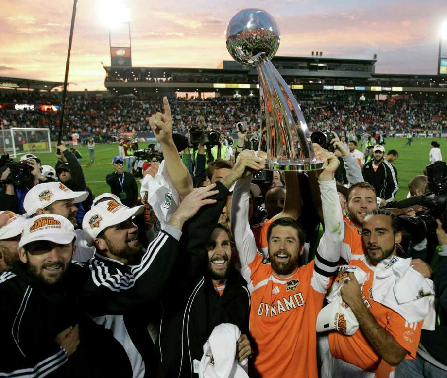 Captain Wade Barrett hoists the MLS Cup after the Dynamo beat the Revs on Nov. 12, 2006. Photo: BRETT COOMER, STAFF / Houston Chronicle