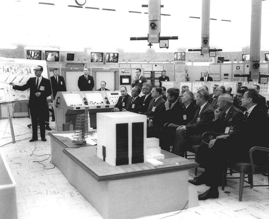 George Mueller briefs President John F. Kennedy and other officials on the Saturn V rocket. Front row, left to right: George Low, Kurt Debus, Robert Seamans, James Webb, President Kennedy, Hugh Dryden, Wernher von Braun, General Leighton Davis, and Senator George Smathers. Photo: NASA / handout