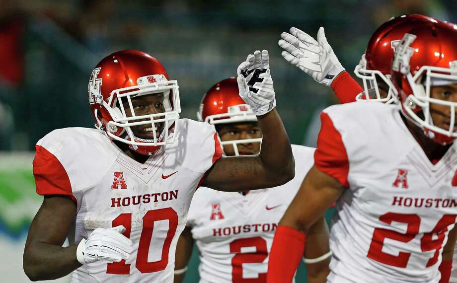 Demarcus Ayers (10) is congratulated for putting the finishing touches on UH's win Friday night by returning a punt 73 yards for a touchdown in the final minute. Photo: Max Becherer, FRE / FR 171354AP