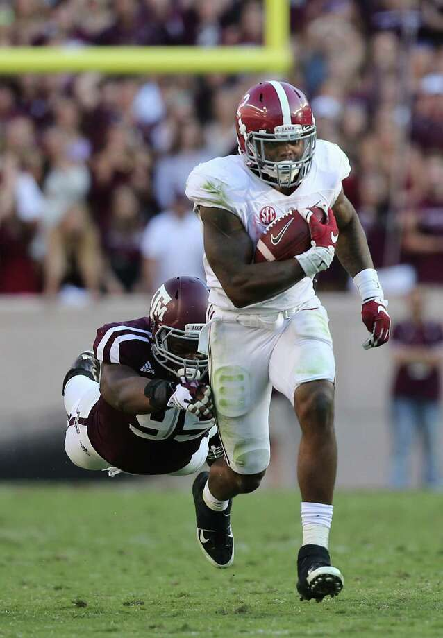 Alabama  running back Derrick Henry blows past A&M's James Lockhart in the third quarter to pick up a portion of the 236 yards he gained on 32 carries Saturday. Photo: Elizabeth Conley, Staff / © 2015 Houston Chronicle
