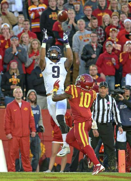 TCU's Josh Doctson hauls in a touchdown catch over Iowa State defensive back Brian Peavy on Saturday. Photo: Paul Moseley, MBR / Fort Worth Star-Telegram